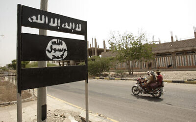 In this Friday, June 15, 2012 file photo, an al-Qaeda logo is seen on a street sign in the town of Jaar in southern Abyan province, Yemen (AP Photo/Hani Mohammed)
