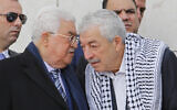 Palestinian Authority President Mahmoud Abbas, left, speaks to senior Fatah official Mahmoud Al-Aloul at the tomb of late Palestinian leader Yasser Arafat inside the Mukataa compound, in the the West Bank city of Ramallah, Nov. 11, 2018. (AP Photo/Nasser Shiyoukhi)