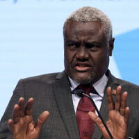 African Union Chairperson Moussa Faki Mahamat addresses the media during a press conference at the EU Africa Forum in Vienna, Austria, December 18, 2018. (AP Photo/Ronald Zak)