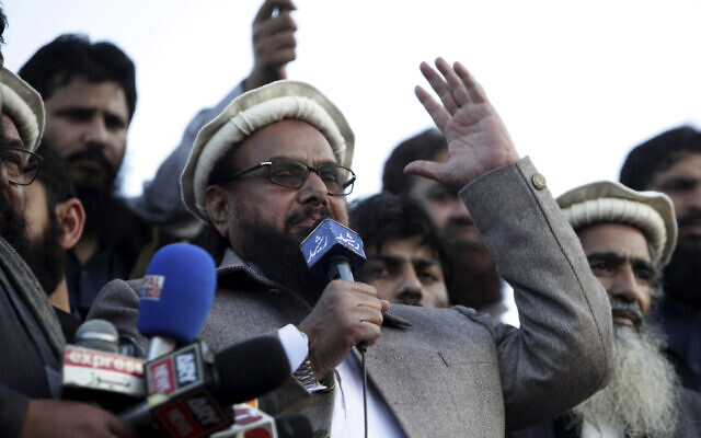 Hafiz Saeed, chief of Pakistani religious group Jamaat-ud-Dawa, addresses a rally for Kashmir Day in Lahore, Pakistan, on February 5, 2019. (AP Photo/K.M. Chaudary)