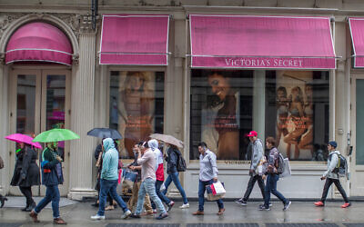Shoppers walk past the Victoria's Secret store on Broadway in the Soho neighborhood of New York, on April 4, 2018. (AP Photo/Mary Altaffer, File)
