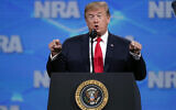 US President Donald Trump speaks at the National Rifle Association Institute for Legislative Action Leadership Forum in Lucas Oil Stadium in Indianapolis, Friday, April 26, 2019. (AP Photo/Michael Conroy)