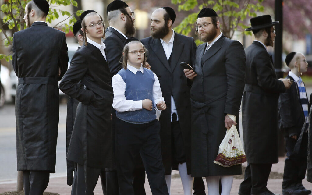 Illustrative image: Ultra-Orthodox Jews stand outside the New Jersey Center for the Performing Arts (NJPAC) while waiting for the start of a Yiddish performance, Wednesday, April 24, 2019, in Newark, New Jersey. (AP Photo/Kathy Willens)