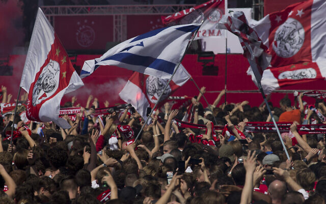 Ajax fans wait for the players to arrive with the trophy when celebrating clinching the Dutch Premier League title in Amsterdam, Netherlands, Thursday, May 16, 2019. (AP/Peter Dejong)