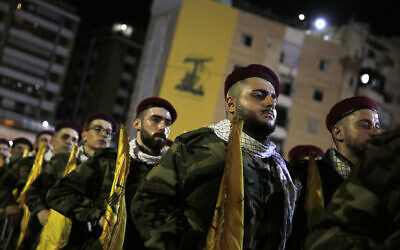 Hezbollah terrorists stand in formation at a rally to mark Jerusalem Day, or Al-Quds Day, in a southern suburb of Beirut, Lebanon, on May 31, 2019. (AP Photo/Hassan Ammar)