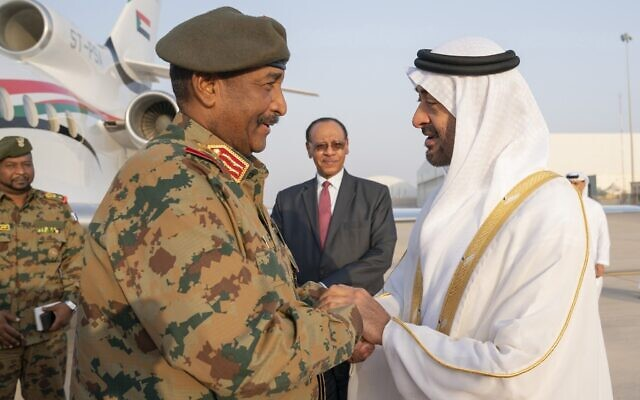 Sheikh Mohamed bin Zayed Al Nahyan, crown prince of Abu Dhabi and deputy supreme commander of the UAE Armed Forces, right, receives Sudanese Gen. Abdel Fattah al-Burhan at the Presidential Airport in Abu Dhabi, United Arab Emirates, May 26, 2019. (Mohamed Al Hammadi/Ministry of Presidential Affairs via AP, File)