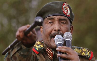 Sudanese Gen. Abdel Fattah al-Burhan, head of the military council, speaks during a military-backed rally, in Omdurman district, west of Khartoum, Sudan, June 29, 2019. (AP Photo/Hussein Malla)