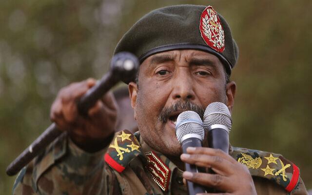 Sudanese Gen. Abdel Fattah al-Burhan, head of the military council, speaks during a military-backed rally, in Omdurman district, west of Khartoum, Sudan, June 29, 2019. (AP Photo/Hussein Malla)