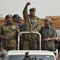 Sudanese Gen. Abdel-Fattah al-Burhan, head of the military council, waves to his supporters upon arriving attend a military-backed rally, in Omdurman district, west of Khartoum, Sudan, June 29, 2019. (AP Photo/Hussein Malla)
