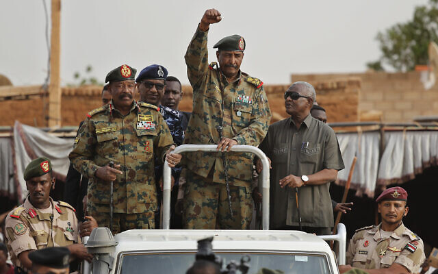 Sudanese Gen. Abdel-Fattah al-Burhan, head of the military council, waves to his supporters upon arriving to attend a military-backed rally, in Omdurman district, west of Khartoum, Sudan, June 29, 2019. (AP Photo/Hussein Malla)