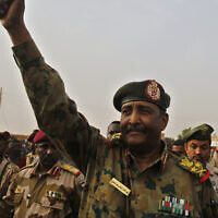 Sudanese Gen. Abdel-Fattah Burhan waves to his supporters at a military-backed rally in Omdurman district west of Khartoum, Sudan, June 29, 2019. (AP Photo/Hussein Malla)