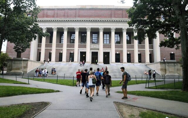 In this Aug. 13, 2019 file photo, students walk near the Widener Library in Harvard Yard at Harvard University in Cambridge, Mass. (AP Photo/Charles Krupa, File)
