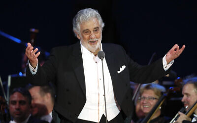 In this August 28, 2019 file photo, opera star Placido Domingo salutes spectators at the end of a concert in Szeged, Hungary (AP Photo/Laszlo Balogh)