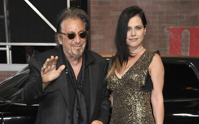 "Al Pacino, left, and Meital Dohan arrive at the Los Angeles premiere of ""The Irishman"" on Oct. 24, 2019, at the TCL Chinese Theatre. (Richard Shotwell/Invision/AP)"
