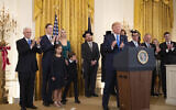 President Donald Trump with, first lady Melania Trump, Vice President Mike Pence, from left, Jared Kushner and Ivanka Trump and their children Arabella Kushner and Joseph Kushner, applaud during a Hanukkah reception in the East Room of the White House Wednesday, Dec. 11, 2019, in Washington. (AP Photo/Manuel Balce Ceneta)