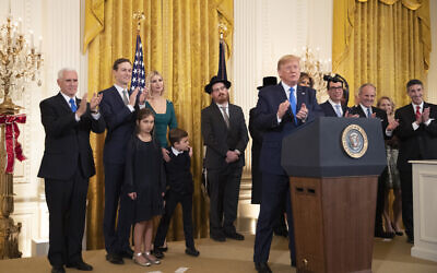 Illustrative: US President Donald Trump with, first lady Melania Trump, Vice President Mike Pence, from left, Jared Kushner and Ivanka Trump and their children Arabella Kushner and Joseph Kushner, applaud during a Hanukkah reception in the East Room of the White House on December 11, 2019, in Washington. (AP/Manuel Balce Ceneta)