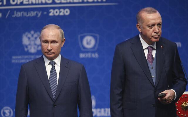 Turkey's President Recep Tayyip Erdogan, right and Russia's President Vladimir Putin, left, attend a ceremony in Istanbul for the inauguration of the TurkStream pipeline, January 8, 2020. (AP Photo/Lefteris Pitarakis)