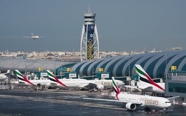 Illustrative: An Emirates jetliner comes in for landing at Dubai International Airport in Dubai, United Arab Emirates. December 11, 2019. (Jon Gambrell/AP)