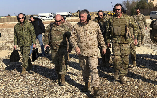 Gen. Frank McKenzie, center front, the top US commander for the Middle East, walks as he visits a military outpost in Syria, on January 25, 2020. (AP Photo/Lolita Baldor)