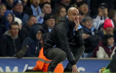 Manchester City's head coach Pep Guardiola reacts after a missed chance to score during the English League Cup semifinal second leg soccer match between Manchester City and Manchester United at Etihad stadium in Manchester, England, Wednesday, Jan. 29, 2020. (AP Photo/Dave Thompson)