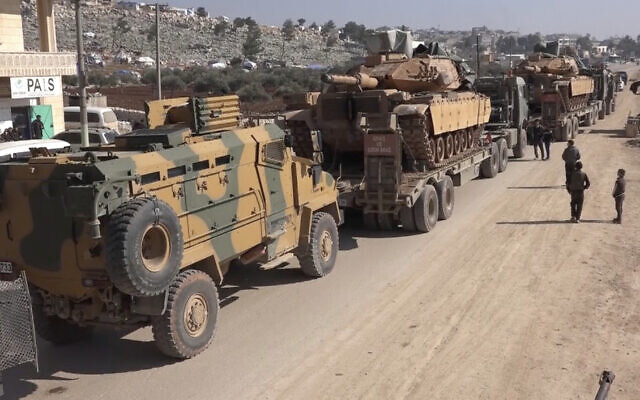 Screen capture from video of a Turkey Armed Forces convoy is seen at the northern town of Sarmada, in Idlib province, Syria, February 2, 2020. (APTN/AP)