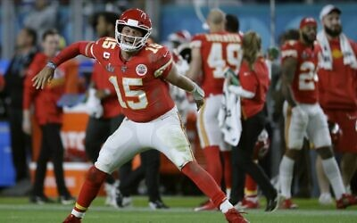 Kansas City Chiefs' quarterback Patrick Mahomes celebrates his touchdown pass to  Damien Williams in the the second half of the NFL Super Bowl 54 football game Feb. 2, 2020, in Miami Gardens, Florida. (AP Photo/John Bazemore)