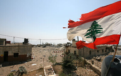 A Lebanese flag flies over Khiam prison, in the southern town of Khiam, Lebanon, August 16, 2006. (Nasser Nasser/AP)