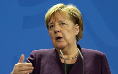 German Chancellor Angela Merkel gestures as she attends a press conference together with Austrian Chancellor Sebastian Kurz after a discussion in Berlin, Germany, Monday, February 3, 2020. (AP Photo/Jens Meyer)