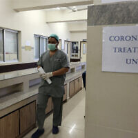 A Pakistan doctor enters an isolation ward set up as a preventative measure following the deadly Coronavirus outbreak, at the Jinnah Postgraduate Medical Center in Karachi, Pakistan, February 3, 2020. (Fareed Khan/AP)