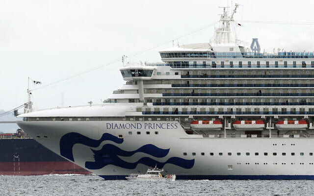 A small boat navigates near the cruise ship Diamond Princess anchoring off the Yokohama Port, in Yokohama, near Tokyo, Japan, February 4, 2020.(Eugene Hoshiko/AP)