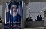 In this Feb. 1, 2020 photo, a poster of Grand Ayatollah Ali al-Sistani is on display with Arabic that reads, 'Peace, father of Iraq,' in Tahrir Square, Baghdad, Iraq  (AP Photo/Khalid Mohammed)
