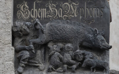 """In this photo from January 14, 2020, the so-called """"Judensau,"""" or """"Jew pig,"""" sculpture is displayed on the facade of the Stadtkirche (Town Church) in Wittenberg, Germany. (AP Photo/Jens Meyer, File )"""