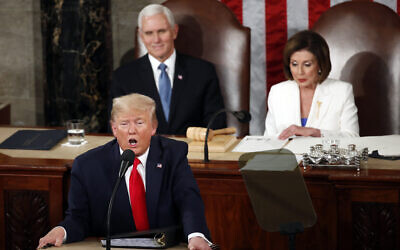 President Donald Trump delivers his State of the Union address to a joint session of Congress on Capitol Hill in Washington, on February 4, 2020, as Vice President Mike Pence listens and House Speaker Nancy Pelosi of California reads. (AP Photo/Alex Brandon)