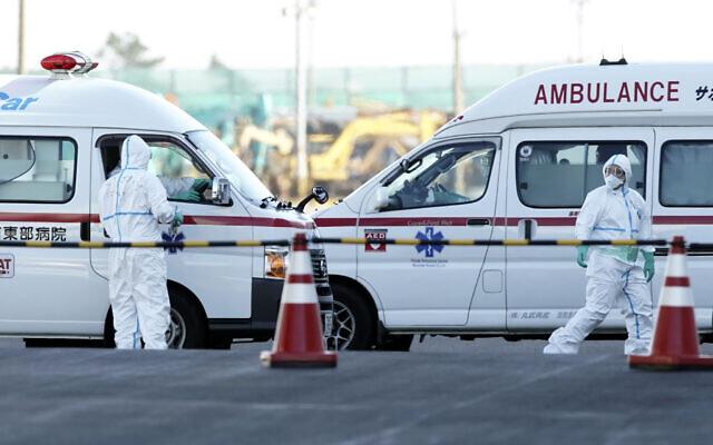 Officials in protective suits prepare near the cruise ship Diamond Princess anchored at Yokohama Port in Yokohama, south of Tokyo, February 6, 2020. (AP Photo/Eugene Hoshiko)