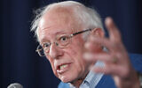 Democratic presidential candidate Sen. Bernie Sanders, I-Vt., gestures while speaking during a news conference at his New Hampshire headquarters, Thursday, Feb. 6, 2020 in Manchester, N.H. (AP Photo/Pablo Martinez Monsivais)