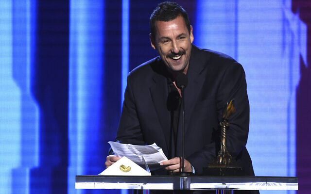 """Adam Sandler accepts the award for best male lead for """"Uncut Gems"""" at the 35th Film Independent Spirit Awards on Saturday, Feb. 8, 2020, in Santa Monica, Calif. (AP Photo/Chris Pizzello)"""