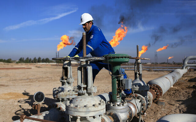 In this Jan. 12, 2017 file photo, a worker operates valves in Nihran Bin Omar field north of Basra, Iraq  (AP Photo/Nabil al-Jurani, File)