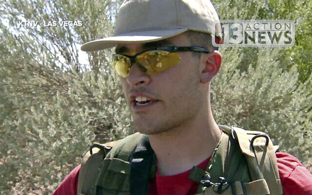 This Sept. 22, 2016, file photo taken from video from KTNV 13 Action News shows Conor Climo during an interview while walking a Las Vegas neighborhood, heavily armed (KTNV 13 Action News via AP, File)