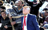 A protester pulls a rope around the neck of a man impersonating US President Donald Trump during a rally at Azadi (Freedom) Square in celebration of the 41st anniversary of the Islamic Revolution, in Tehran, Iran, February 11, 2020. (AP Photo/Ebrahim Noroozi)