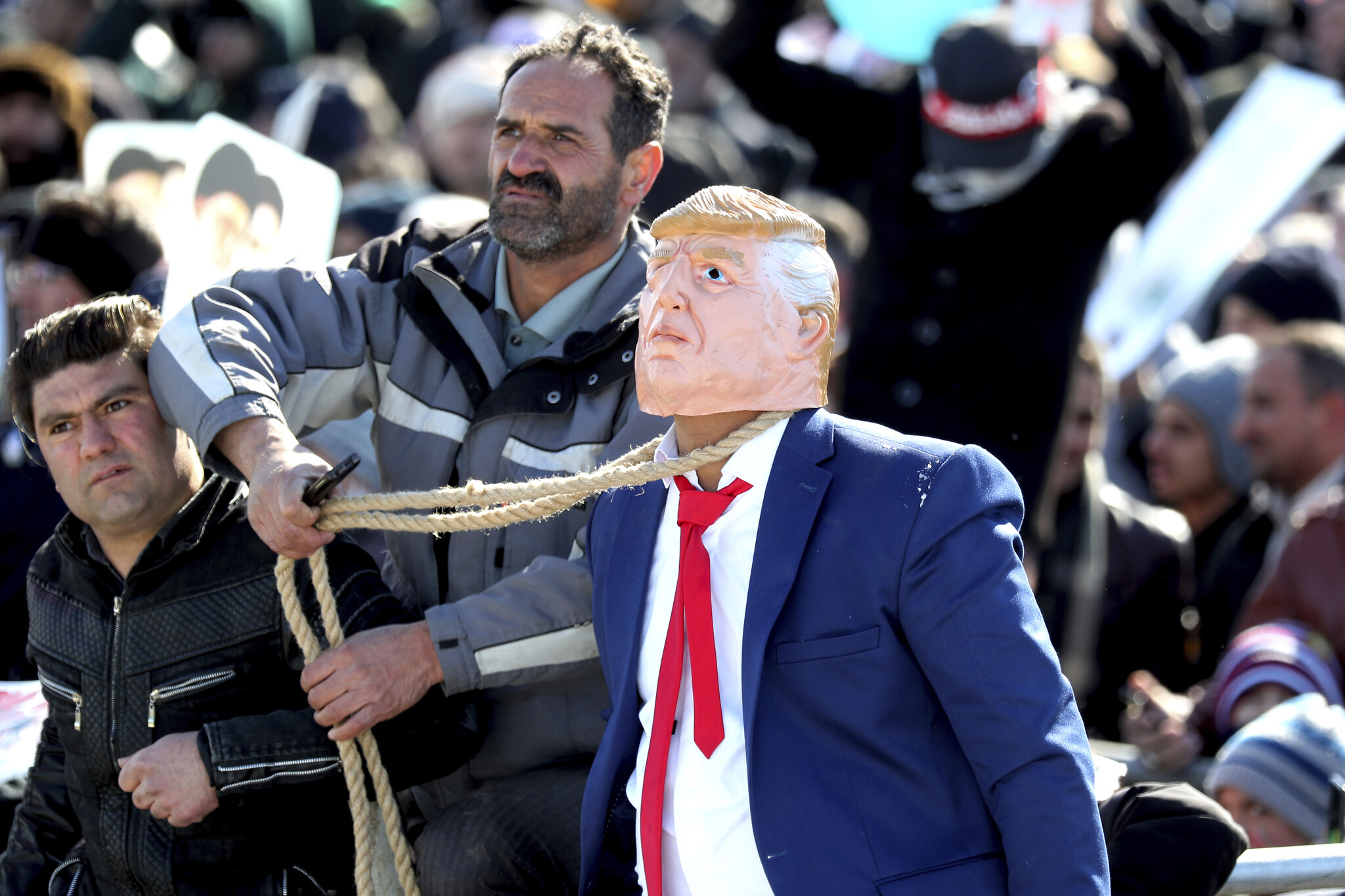 A protester pulls a rope around the neck of a man impersonating US President Donald Trump during a rally at Azadi Square in celebration of the 41st anniversary of the Islamic Revolution in Tehran Iran