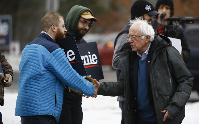 Democratic presidential candidate Sen. Bernie Sanders, I-Vt., meets with people outside a polling place where voters will cast their ballots in a primary election, in Manchester, N.H., Tuesday, Feb. 11, 2020. (AP/Matt Rourke)