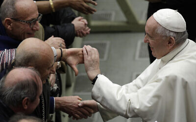Pope Francis is greeted by faithful during the weekly general audience at the Vatican, February 12, 2020. (AP Photo/Gregorio Borgia)