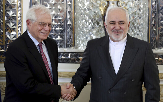 Iranian Foreign Minister Mohammad Javad Zarif, right, and European Union foreign policy chief Josep Borrell shake hands prior to their meeting in Tehran, Iran, February 3, 2020. (AP Photo/Ebrahim Noroozi, File)
