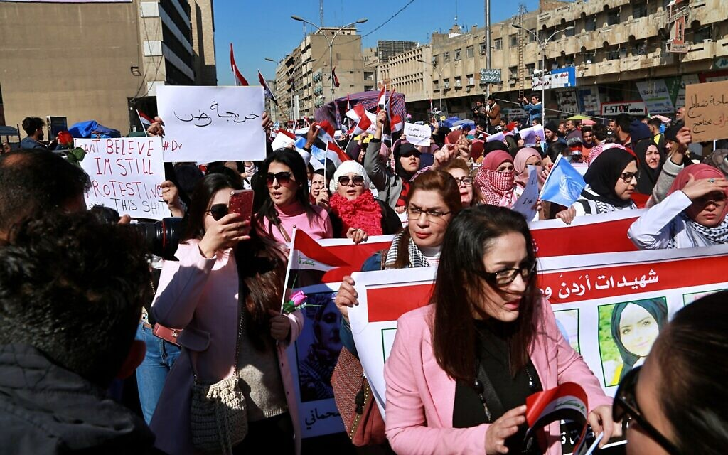Defying radical cleric, Iraqi women protesters take to streets