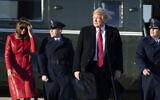 US President Donald Trump walks to Air Force One with first lady Melania Trump as he departs at Andrews Air Force Base, Maryland, February 14, 2020. (Alex Brandon/AP)