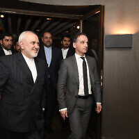 German Foreign Minister Heiko Maas, right, meets with Iran's Foreign Minister Mohammad Javad Zarif, left, during the 56th Munich Security Conference in Munich, Germany, February 15, 2020. (Thomas Kienzle/Pool via AP)