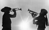 In this August 9, 1967, file photo, two boy scout members play the bugle at the 12th World Boy Scout Jamboree at Farragut State Park in Idaho (AP Photo/Jack Kanthal, File)