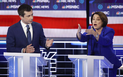 Democratic presidential candidates, Sen. Amy Klobuchar, Democat-Minnesota, right, speaks as former South Bend Mayor Pete Buttigieg looks on during a Democratic presidential primary debate hosted by NBC News and MSNBC in Las Vegas, February 19, 2020. (John Locher/AP)