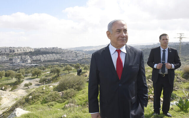 Prime Minister Benjamin Netanyahu stands at an overview of the East Jerusalem neighborhood of Har Homa where he announced a new neighborhood is to be built, Feb. 20, 2020. (Debbie Hill/Pool via AP)
