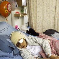 Nine-year-old Palestinian boy Malik Eissa rests in Hadassa hospital in Jerusalem, Thursday, Feb. 20, 2020 (AP Photo/Mahmoud Illean)